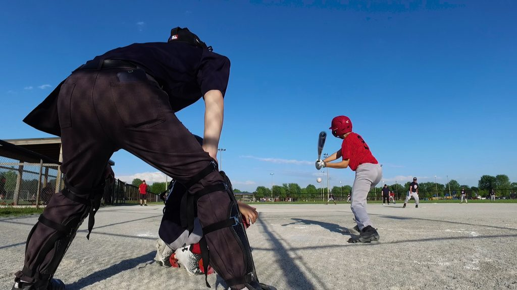 boy up to bat at a baseball diamond