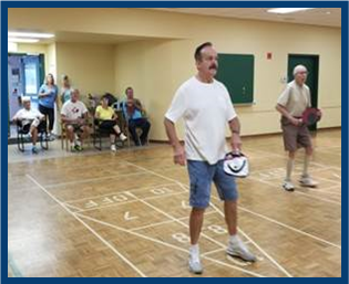 Participants playing pickleball at the Strangway Centre